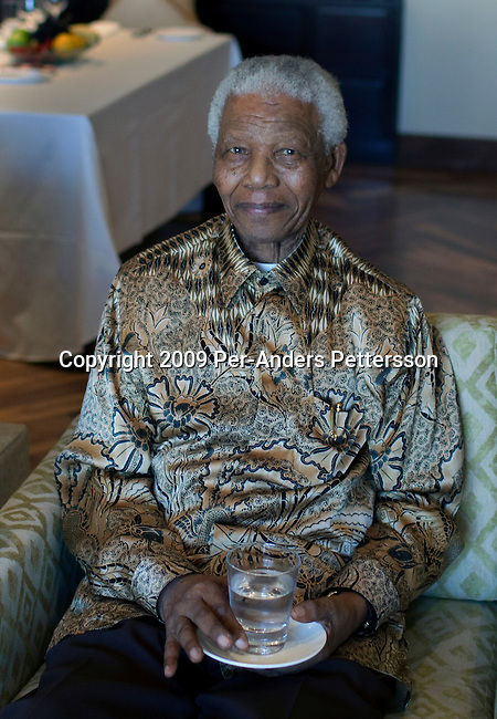 CAPE TOWN, SOUTH AFRICA - APRIL 2: Former President Nelson Mandela of South Africa poses for a portrait on April 2, 2009 in a hotel room at the One&Only hotel in Cape Town, South Africa. The ANC freedom fighter was in prison for 27 years and released in 1990. He became President of South Africa after the first multiracial democratic elections in April 1994. Mr. Mandela retired after one term in 1999. (Photo by Per-Anders Pettersson/Getty Images).