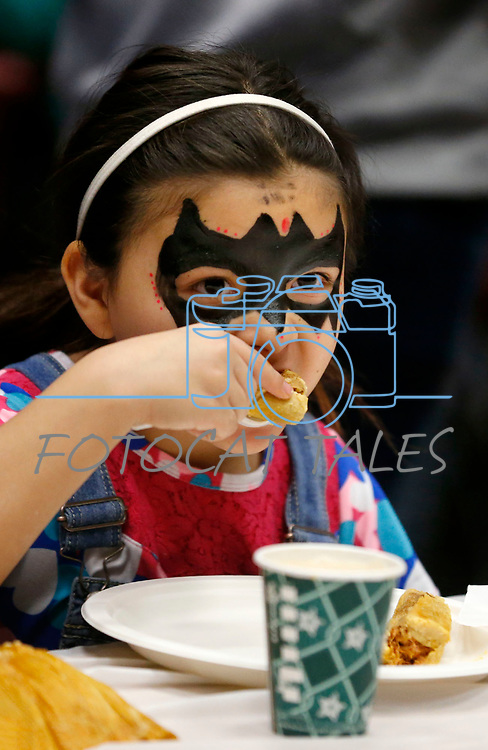 Gissel Anguiano, 8, enjoys lunch at the La Posada Celebration at Western Nevada College, in Carson City, Nev., on Saturday, Dec. 15, 2018. <br /> Photo by Cathleen Allison/Nevada Momentum