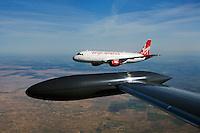 aerial photograph of N628VA, Virgin America Airlines Airbus A320-214, California from a Lear 25 with the fuel tip tank in the foreground