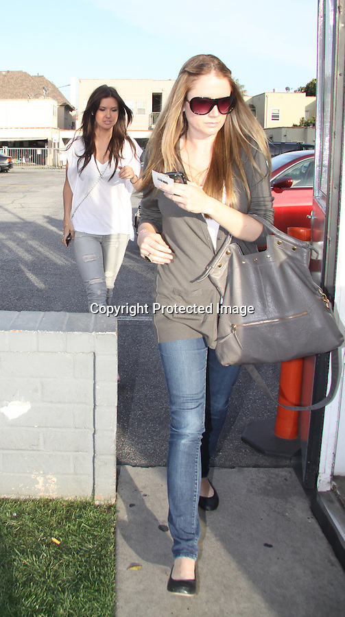 Feb 25th 2010..Audrina Patridge went to get her nails done at a store called Lynn's Nails in Hollywood califonia. White CHANEL Cc purse. ...AbilityFilms@yahoo.com.805-427-3519.www.AbilityFilms.com