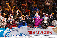 The crowd is excited to see Pete Kaiser cross the Nome finish line to win the 2019 Iditarod Trail Sled Dog Race. Pete's winning time is 9 days 12 hours 39 minutes and 6 seconds<br /> <br /> Photo by Jeff Schultz/  (C) 2019  ALL RIGHTS RESERVED