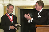 "The British Ambassador, Sir Christopher Meyer KCMG, applauds after conferring Honorary Knighthood on film director Steven Spielberg at a ceremony at the British Embassy in Washington, DC on January 29, 2001.  In his remarks the Ambassador said ""The award of an Honorary Knighthood to Steven Allan Spielberg is in recognition of his unique and outstanding contribution to international film, and in particular his services to the entertainment industry of the United Kingdom"".  He concluded by saying "" Mr. Spielberg epitomises the cultural partnership between our two countries.  I am privileged to present this historic award tonight on behalf of Her Majesty the Queen""..Credit: Ron Sachs / Pool via CNP"
