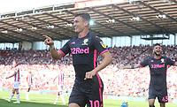 Leeds United's Ezgjan Alioski celebrates scoring his side's second goal <br /> <br /> Photographer Stephen White/CameraSport<br /> <br /> The Premier League - Stoke City v Leeds United - Saturday August 24th 2019 - bet365 Stadium - Stoke-on-Trent<br /> <br /> World Copyright © 2019 CameraSport. All rights reserved. 43 Linden Ave. Countesthorpe. Leicester. England. LE8 5PG - Tel: +44 (0) 116 277 4147 - admin@camerasport.com - www.camerasport.com