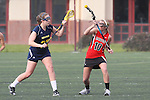 Santa Barbara, CA 02/18/12 - Maddie Palmer (Michigan #27) and Emma Goodnow (Georgia #10) in action during the Georgia-Michigan matchup at the 2012 Santa Barbara Shootout.  Georgia defeated Michigan 12-10.