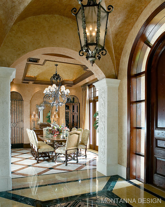 "The tile and stone patterns create an ""area rug"" design in this Mediterranean interior"