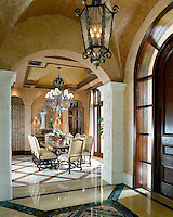 """The tile and stone patterns create an """"area rug"""" design in this Mediterranean interior"""