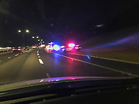 An Austin Police Department (APD) police cruisers with the lights flashing has stopped a speeding car along the Loop 1 Mopac MoPac Expressway in north Austin, Texas.