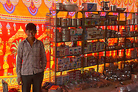 Along the road in the Thar desert locals selling their wares from basic Kitchen ware to materials in particular during or after a special fair or local festival. Rajasthan, India
