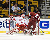 Kieran Millan (BU - 31) stops Colin Blackwell (Harvard - 63) - The Boston University Terriers defeated the Harvard University Crimson 3-1 in the opening round of the 2012 Beanpot on Monday, February 6, 2012, at TD Garden in Boston, Massachusetts.