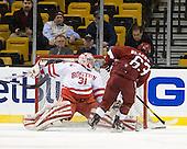 Kieran Millan (BU - 31) stops Colin Blackwell (Harvard - 63) - The Boston University Terriers defeated the Harvard University Crimson 3-1 in the opening round of the 2012 Beanpot on Monday, February 6, 2012, at TD Garden in Boston, Massachusetts.