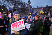 People's Vote campaigners gather in Pariament Square on the day MPs voted decisively to reject Theresa May's withdrawal deal with the EU.  Westminster, London.