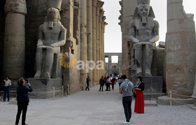 The Luxor Temple, large ancient Egyptian temple complex located on the port city of Luxor, south of Cairo Egypt, on March 20, 2017. The city of Luxor, ancient Egyptian city of Thebes. Recognized as the greatest open-air museum of the world for the ruins of the temple complexes at Karnak and Luxor stand within the modern city. Immediately opposite, across the River Nile, lie the monuments, temples and tombs of the West Bank Necropolis, which includes the Valley of the Kings and Valley of the Queens. Thousands of tourists from all around the world arrived annually to visit these monuments contributing greatly to the economy of the modern city. Now the tourism in Egypt is deeply decreased and the city is facing a big crisis. Photo by Amr Sayed
