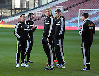 Pictured L-R: Swansea players Leon Britton, Alejandro Pozuelo, David Cornell, Ben Davies and Pablo Hernandez on the pitch before kick off.  01 February 2014<br /> Re: Barclay's Premier League, West Ham United v Swansea City FC at Boleyn Ground, London.