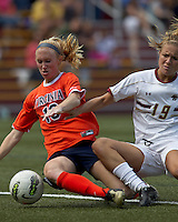 Boston College midfielder Kristen Mewis (19) fails to connect on a cross as University of Virginia midfielder/defender Maggie Kistner (16) defends. Boston College defeated University of Virginia, 2-0, at the Newton Soccer Field, on September 18, 2011.