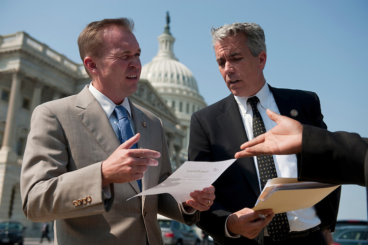 UNITED STATES - SEPTEMBER 14: Rep. Mick Mulvaney, R-S.C., left, and Rep. Joe Walsh, R-Ill., talk before the start of the news conference to call for a repeal of the three percent withholding provision on government contracts on Wednesday, Sept. 14, 2011. (Photo By Bill Clark/Roll Call)