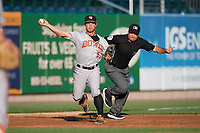 Bowie Baysox third baseman Sean Coyle (5) throws to first base as umpire Zach Tieche signals fair ball during a game against the Harrisburg Senators on May 16, 2017 at FNB Field in Harrisburg, Pennsylvania.  Bowie defeated Harrisburg 6-4.  (Mike Janes/Four Seam Images)