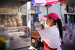"""A worker prepares nachos from a kiosk along Middlefield Rd., known as """"Little Mexico,"""" in Redwood City, Ca., on Tuesday, May 10, 2011. Along the San Francisco peninsula, just beyond the city's suburbs, a group of Asian Americans and Latinos are suing San Mateo County for what it calls a discriminatory voting system. The county has elected no Asians and just one Latino supervisor in the past 25 years even though its population is now a quarter Latino and a quarter Asian."""