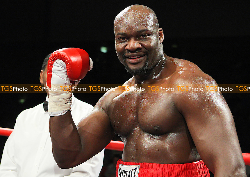 Larry Olubamiwo (red shorts) defeats Colin Kenna in a Heavyweight boxing contest for the Southern Area Title at Goresbrook Leisure Centre, Dagenham, promoted by Frank Maloney - 14/05/10 - MANDATORY CREDIT: Gavin Ellis/TGSPHOTO - Self billing applies where appropriate - Tel: 0845 094 6026