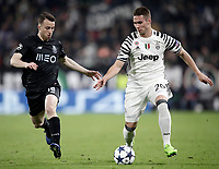 Juventus' Marko Pjaca, right, is challenged by Porto's Diogo Jota during the Champions League round of 16 soccer match against Porto at Turin's Juventus Stadium, 14 March 2017. Juventus won 1-0 (3-0 on aggregate) to reach the quarter finals.<br /> UPDATE IMAGES PRESS/Isabella Bonotto
