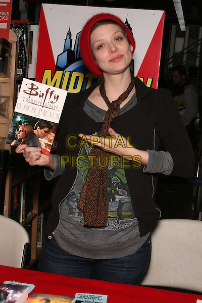 """AMBER BENSON.at the Book Signing for """"Cat's Claw"""" at Midtown Comics Times Square, New York, NY, USA, .February 27th, 2010..half length brown scarf  black grey gray top red hat beanie jacket holding hand gesture .CAP/LNC/TOM.©LNC/Capital Pictures"""