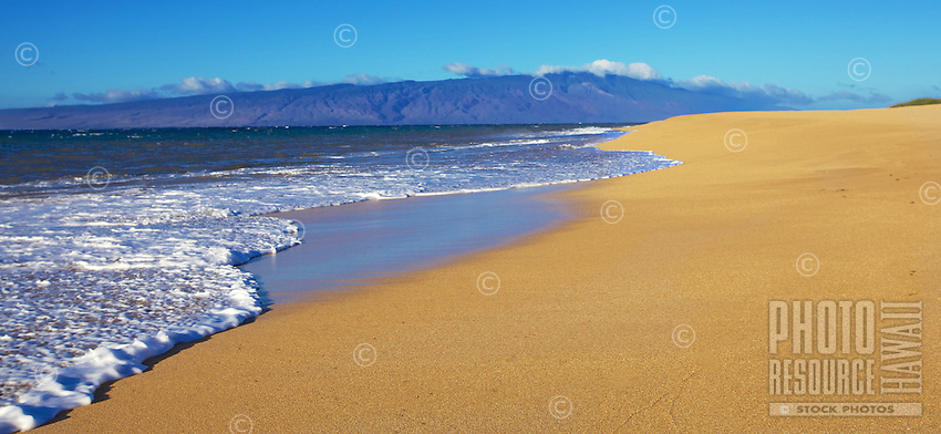 Foamy waves reach the shore of Polihua Beach, Lana'i.