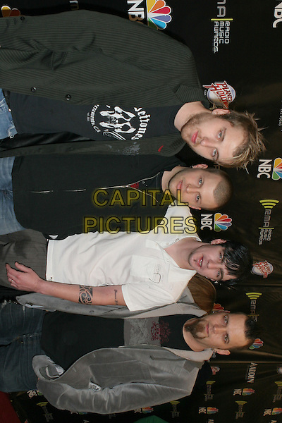 "THREE DAYS GRACE.2005 Radio Music Awards - Arrivals held at the Aladdin Hotel, Las Vegas, Nevada..December 19th, 2005.Photo: Zach Lipp/AdMedia/Capital Pictures.Ref: ZL/ADM.half length nominees, Song of the Year/Alternative and Act Rock Radio Song of the Year for ""Just Like You"".www.capitalpictures.com.sales@capitalpictures.com.© Capital Pictures."