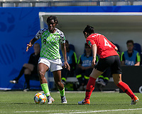 GRENOBLE, FRANCE - JUNE 12: Asisat Oshoala #8 of the Nigerian National Team dribbles Boram Hwang #4 of the Korean National Team defends during a game between Korea Republic and Nigeria at Stade des Alpes on June 12, 2019 in Grenoble, France.