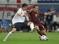 Portuguese midfielder (8) Petit fights for the ball with English midfielder (16) Owen Hargreaves.  Portugal defeated England on penalty kicks after playing to a 0-0 tie in regulation in their FIFA World Cup quarterfinal match at FIFA World Cup Stadium in Gelsenkirchen, Germany, July 1, 2006.