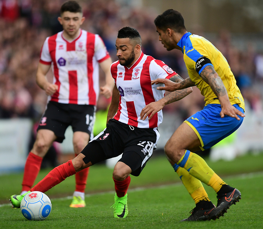 Lincoln City's Nathan Arnold vies for possession with Torquay United's Aman Verma<br /> <br /> Photographer Chris Vaughan/CameraSport<br /> <br /> Vanarama National League - Lincoln City v Torquay United - Friday 14th April 2016  - Sincil Bank - Lincoln<br /> <br /> World Copyright &copy; 2017 CameraSport. All rights reserved. 43 Linden Ave. Countesthorpe. Leicester. England. LE8 5PG - Tel: +44 (0) 116 277 4147 - admin@camerasport.com - www.camerasport.com