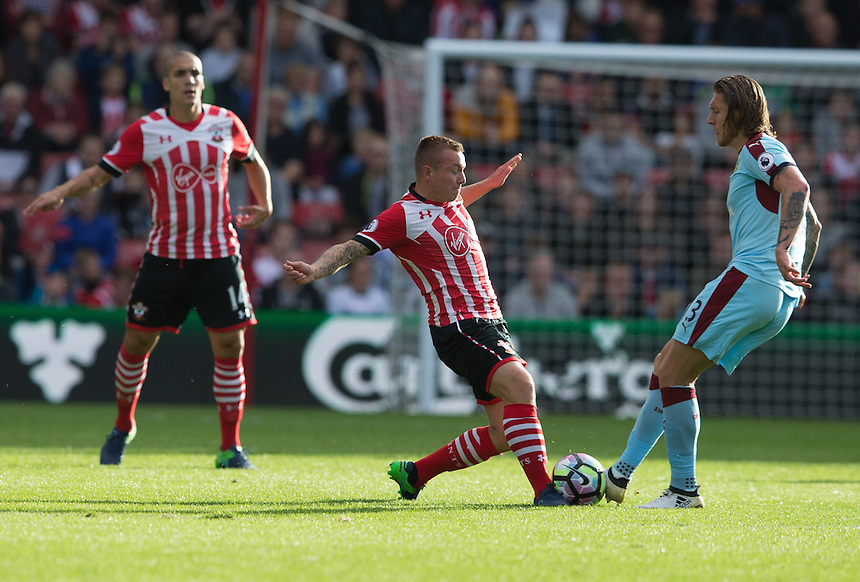 Southampton's Jordy Clasie battles for the ball with Burnley's Jeff Hendrick<br /> <br /> Photographer James Williamson/CameraSport<br /> <br /> The Premier League - Southampton v Burnley - Sunday 16th October 2016 - St Mary's Stadium - Southampton<br /> <br /> World Copyright &copy; 2016 CameraSport. All rights reserved. 43 Linden Ave. Countesthorpe. Leicester. England. LE8 5PG - Tel: +44 (0) 116 277 4147 - admin@camerasport.com - www.camerasport.com