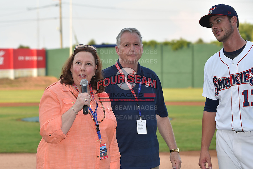 Tennessee Smokies third baseman Kris Bryant #17 watches on as the league president Lori Webb congratulates him for winning the Southern League Home Run Derby at Engel Stadium on June 16, 2014 in Chattanooga, Tennessee.  (Tony Farlow/Four Seam Images)