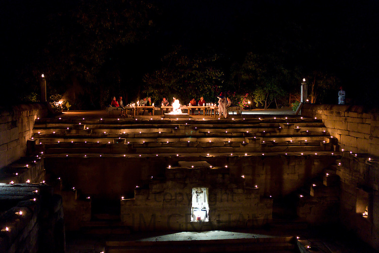 Guests at candlelight dinner at The Stepwell, Rawla Narlai hotel in Rajasthan, India
