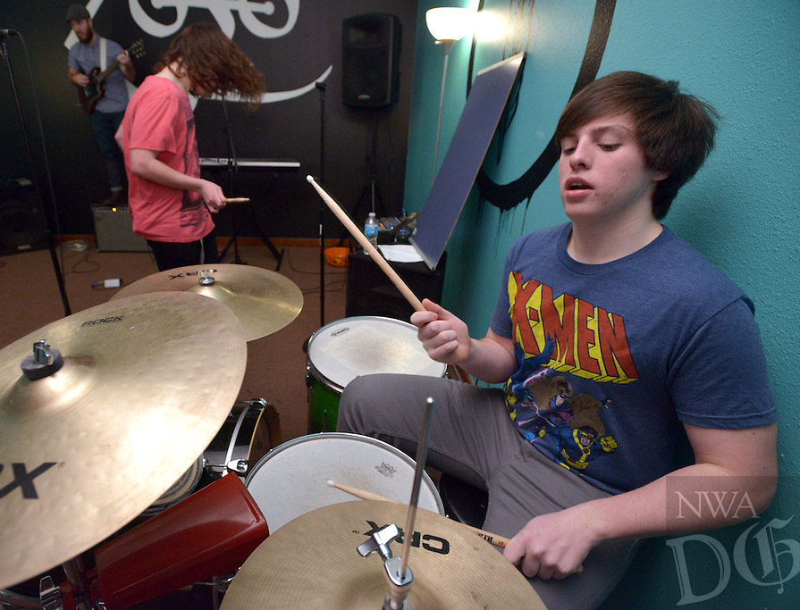 STAFF PHOTO BEN GOFF  @NWABenGoff -- 12/27/14 Carson Little, 15, of Bentonville plays the drums as the dean's list advanced group rehearses at the School of Rock in Rogers on Saturday Dec. 27, 2014. The students are preparing for their next public performance, which will be during Last Night Fayetteville on December 31.