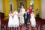 Scoil Ceann Tra pupils Ríona Ní Mhuircheartaigh Alegbe, Katie Ní Ealaithe, Jesse Mac Caarthaigh, Cuan Ó Fiannachta, Ben de Brún and Carol de Nais the day of their First Communion, pictured with their muinteoir Cristín Uí Chonchúir and fr. Joe Begley at Caitlín Naofa Church, Ventry, on Sunday morning.