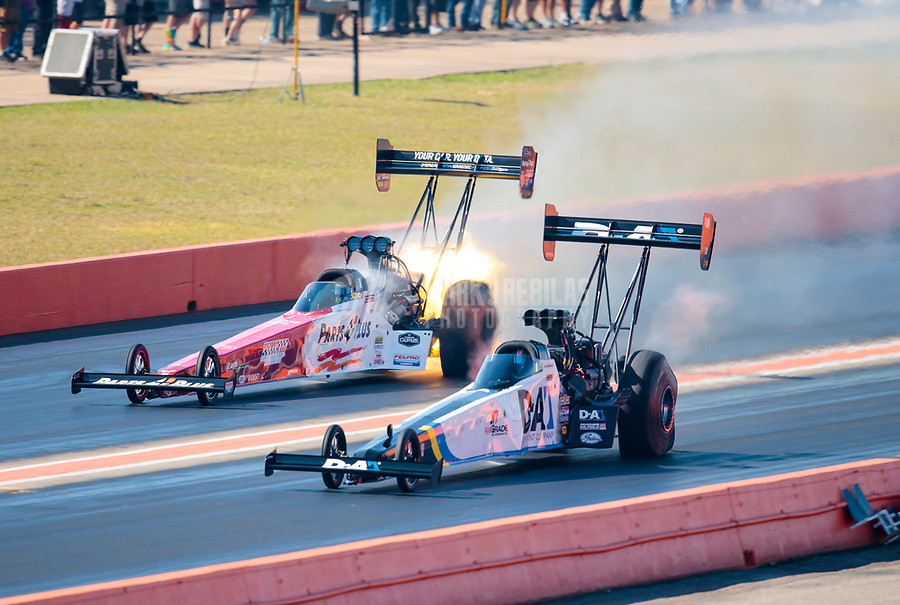 Oct 20, 2019; Ennis, TX, USA; NHRA top fuel driver Jordan Vandergriff (near) against Clay Millican during the Fall Nationals at the Texas Motorplex. Mandatory Credit: Mark J. Rebilas-USA TODAY Sports