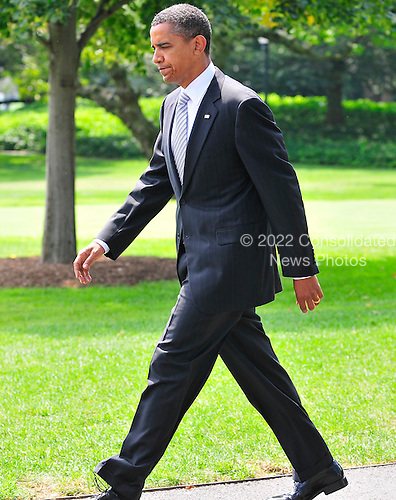 United States President Barack Obama walks from the Oval Office to make a statement on the economy and small businesses on the South Lawn of the White House in Washington, D.C. on Thursday, August 19, 2010..Credit: Ron Sachs / Pool via CNP