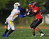 Plainedge No. 20 Oscar Jimenez, right, and Lawrence No. 6 Brandon Patterson compete against one another in the fourth quarter of a Nassau County Conference III varsity football game at Plainedge High School on Saturday, October 17, 2015.<br /> <br /> James Escher
