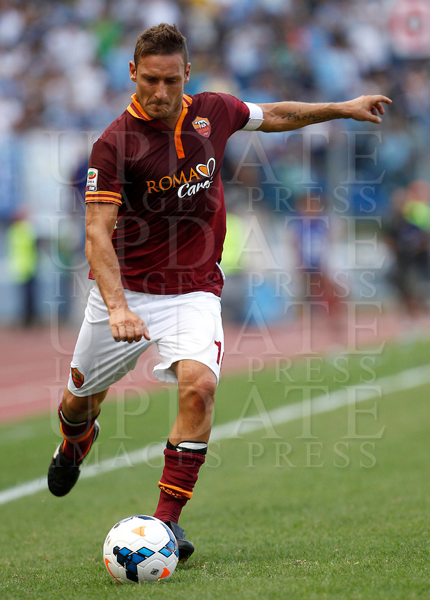 Calcio, Serie A: Roma vs Lazio. Roma, stadio Olimpico, 22 settembre 2013.<br /> AS Roma forward Francesco Totti kicks the ball during the Italian Serie A football match between AS Roma and Lazio, at Rome's Olympic stadium, 22 September 2013.<br /> UPDATE IMAGES PRESS/Isabella Bonotto
