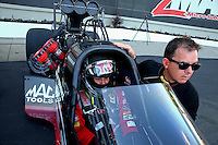 Sep 13, 2013; Charlotte, NC, USA; Steve Torrence (right) with father NHRA top fuel dragster driver Billy Torrence during qualifying for the Carolina Nationals at zMax Dragway. Mandatory Credit: Mark J. Rebilas-