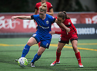 Seattle, Washington - Saturday May 14, 2016: Seattle Reign FC midfielder Kim Little (8) is defended by Portland Thorns FC midfielder Meleana Shim (6) during the first half of a match at Memorial Stadium on Saturday May 14, 2016 in Seattle, Washington. The match ended in a 1-1 draw.
