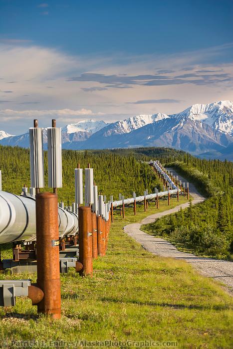 Trans Alaska oil pipeline traverses the tundra near the pass of the Alaska mountain range, south of Delta Junction, Alaska.