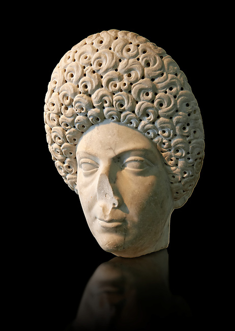 Roman portrait bust of a flavian women possibly Domita, circa 69-96 AD excavated from Terracina. This portrait can be dated from the typical hairstyle made popular by Flavian women. It may be of Domitia Longina who was  wife to the Roman Emperor Domitian. The National Roman Museum, Rome, Italy