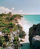 MEXICO, Maya Riviera, Tulum Ruins and beach with swimmers