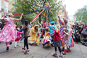 Covent Garden, London, UK. 11 May 2014. Maypole dance. The Covent Garden May Fayre and Puppet Festival takes place at St Paul's Church.