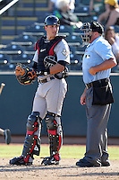 Salt River Rafters catcher Jason Castro #18 talks with umpire Eric Loveless during an Arizona Fall League game against the Phoenix Desert Dogs at Phoenix Municipal Stadium on November 1, 2011 in Phoenix, Arizona.  Salt River defeated Phoenix 10-7.  (Mike Janes/Four Seam Images)