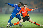 St Johnstone v Dundee United....22.02.11 .Timothy Van der Meulen tackles Collin Samuel.Picture by Graeme Hart..Copyright Perthshire Picture Agency.Tel: 01738 623350  Mobile: 07990 594431