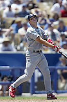 Mike Matheny of the St. Louis Cardinals bats during a 2002 MLB season game against the Los Angeles Dodgers at Dodger Stadium, in Los Angeles, California. (Larry Goren/Four Seam Images)
