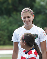 Portland Thorns FC forward Alex Morgan (13). In a National Women's Soccer League (NWSL) match, Portland Thorns FC (white/black) defeated Boston Breakers (blue), 2-1, at Dilboy Stadium on July 21, 2013.