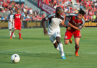 18 July 2012: Colorado Rapids forward Omar Cummings #14 and Toronto FC defender Logan Emory #2 in action during an MLS game between the Colorado Rapids and Toronto FC at BMO Field in Toronto..Toronto FC won 2-1..