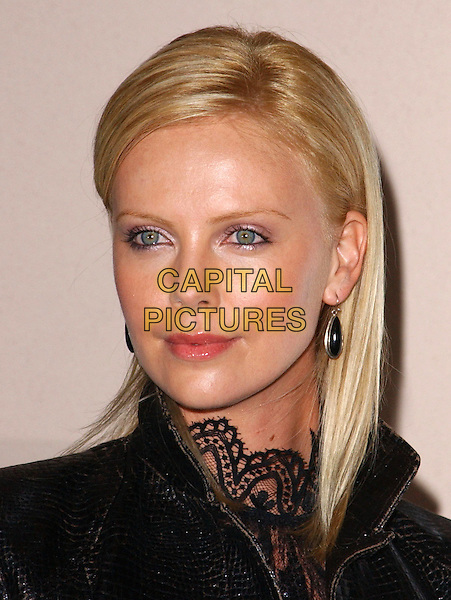CHARLIZE THERON.attends Aileen:The Life and Death of a Serial Killer screening held at The Museum of Tolerance in Los Angeles, California.6 January 2004   .*UK Sales Only*     .headshot, portrait                                             .www.capitalpictures.com.sales@capitalpictures.com.©Capital Pictures.